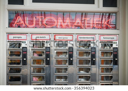 ZWOLLE, NETHERLANDS - MARCH 22, 2015: Vending machine with practical products like umbrellas, toothpaste, licorice, deo spray and bicycle lamps on the zwolle trains station - stock photo
