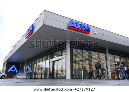 ZWOLLE, THE NETHERLANDS - JANUARY 27, 2016: A new restyled ALDI discount Supermarket, in the new house style of Aldi Nord. Aldi is a leading global discount supermarket chain with over 9,000 stores. - stock photo