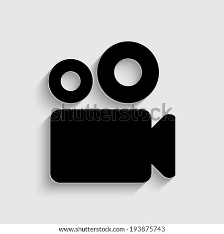 Video camera icon with shadow on a grey background - stock vector