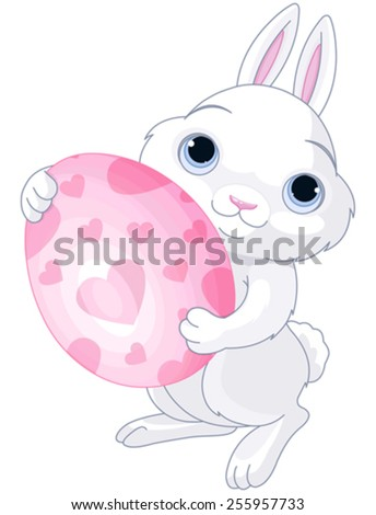 A cute Easter bunny holds brightly colored egg - stock vector