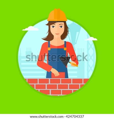 A female bricklayer in uniform and hard hat with a spatula and a brick in hands on a background of construction site. Vector flat design illustration in the circle isolated on background. - stock vector