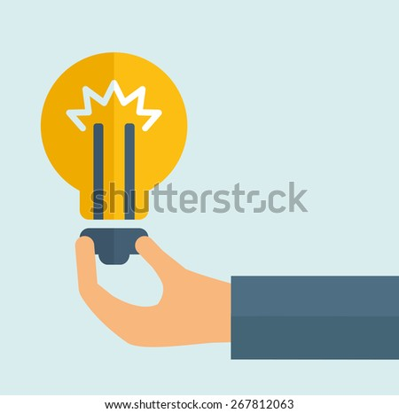 A hand holding colorful bright incandescent light bulb  - stock vector