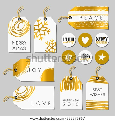 A set of Christmas gift tags and stickers in black, white and gold. Traditional Christmas elements, abstract brush strokes and doodles and modern typographic designs. - stock vector