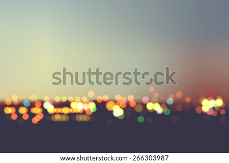 Abstract blur bokeh in night city background - stock vector