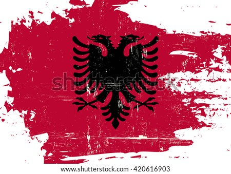 Albania scratched Flag. An Albanian flag with a grunge texture - stock vector