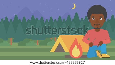 An african-american man kindling a campfire on the background of camping site with tent. Tourist relaxing near campfire. Vector flat design illustration. Horizontal layout. - stock vector