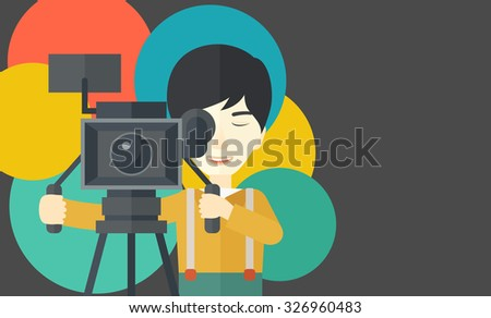 An Asian cameraman looking through movie camera on a tripod vector flat design illustration. Horizontal layout with a text space. - stock vector