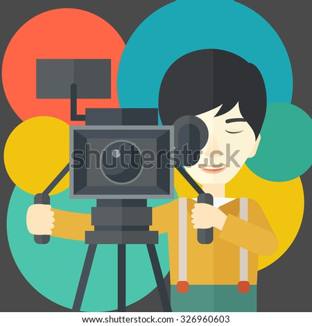 An Asian cameraman looking through movie camera on a tripod vector flat design illustration. Square layout. - stock vector