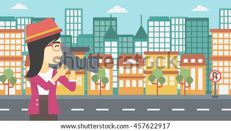 An asian young female cameraman looking through movie camera. Woman with professional video camera in the city. Woman shooting outdoor. Vector flat design illustration. Horizontal layout. - stock vector