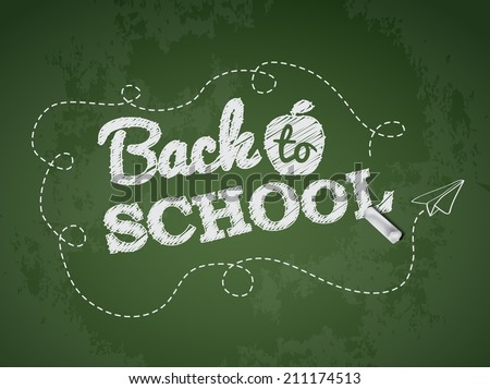 Back to school text on green chalkboard - stock vector