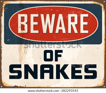 Beware of snakes - Vintage Metal Sign with realistic rust and used effects. - stock vector