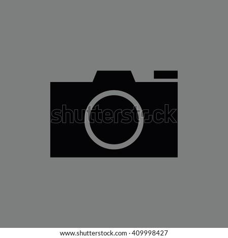 Black camera vector icon. Gray background - stock vector