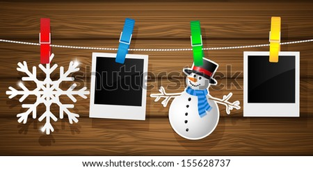 Blank photo frames and snowflakes on a clothesline. Vector illustration.  - stock vector
