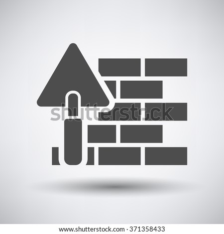 Brick wall with trowel icon on gray background with round shadow. Vector illustration. - stock vector