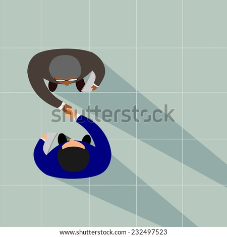 Business partners shaking hands as a symbol of unity, view from the top.vector - stock vector