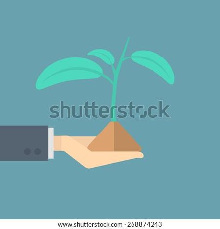 businessman holding seedling - stock vector