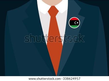 Businessman In Suit Wearing Libya Badge. Country flag badge closeup. Vector illustration - stock vector