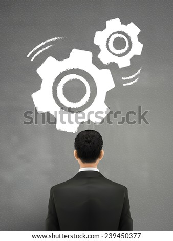 businessman looking at gears sketch over grey  - stock vector