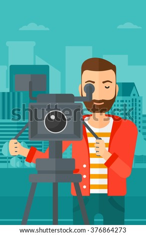 Cameraman with movie camera on a tripod. - stock vector