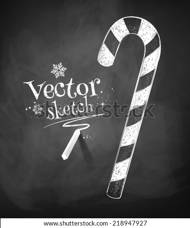 Chalkboard drawing of Christmas candy cane. Vector illustration. Isolated. - stock vector