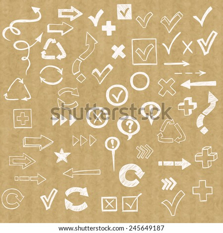 Check marks, check boxes and arrows drawn in a doodled style, isolated on brown kraft paper background. - stock vector