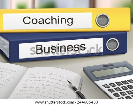 coaching and business binders isolated on the office table - stock vector