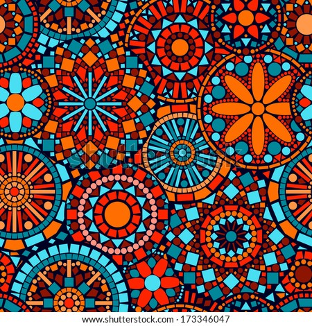 Colorful circle flower mandalas seamless pattern in blue red and orange, vector - stock vector