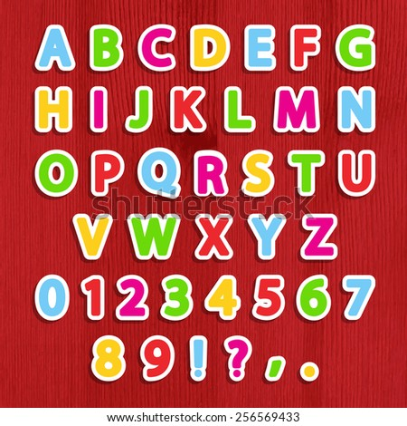 Cut vector alphabet sticker set in bright colors on wooden background. Vector illustration. Eps10. - stock vector