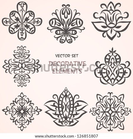 Decorative floral elements. Can be used for backgrounds, packaging, invitations,vintage cards, wrapping paper. Vintage design elements - stock vector