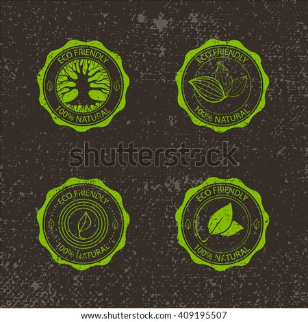 Eco Vintage Labels Bio template set on blurred forest background. Ecology theme. Retro logo, icon, badge template designs with leaves and tree silhouette. - stock vector
