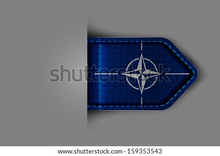 Flag of NATO in the form of a glossy textured label or bookmark. Vector illustration. - stock vector