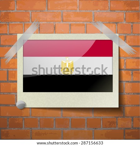 Flags of Egypt scotch taped to a red brick wall. Vector - stock vector