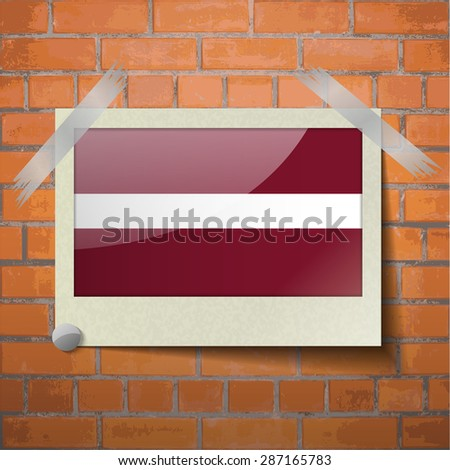 Flags of Latvia scotch taped to a red brick wall. Vector - stock vector