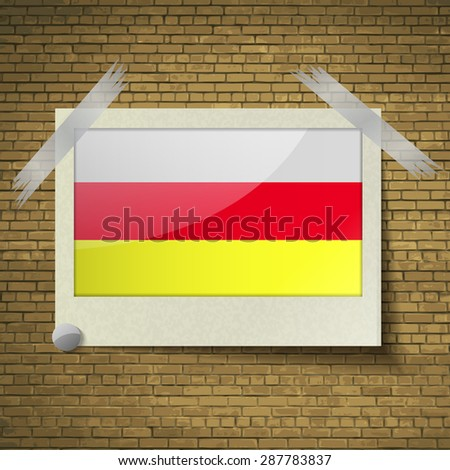 Flags of North Ossetia at frame on a brick background. Vector illustration - stock vector