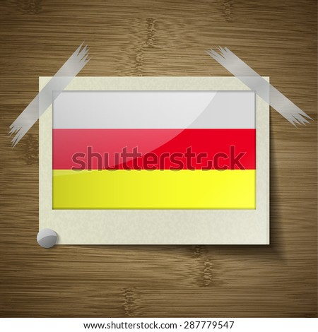 Flags of North Ossetia at frame on wooden texture. Vector illustration - stock vector