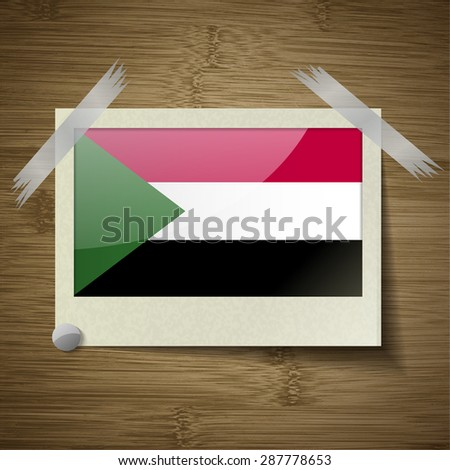Flags of Sudan at frame on wooden texture. Vector illustration - stock vector