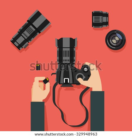 Flat design vector illustration of hands with camera and photography equipment - stock vector