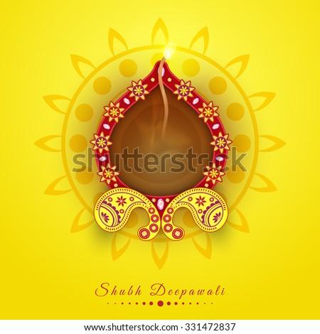 Floral decorated elegant illuminated oil lit lamp on rangoli for Indian Festival of Lights, Happy Diwali celebration. - stock vector