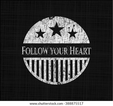 Follow your Heart written on a blackboard - stock vector