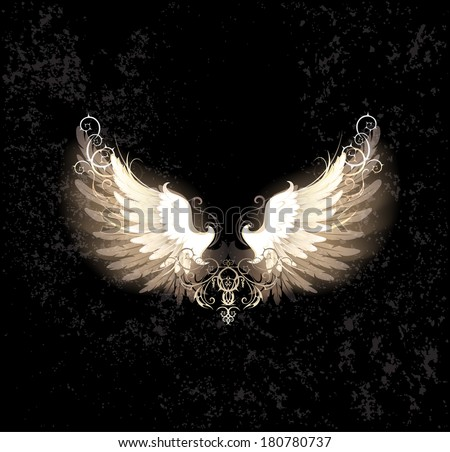 glowing angel wings , decorated with a pattern on a dark textural background. - stock vector