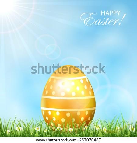 Golden Easter egg in the grass and blue sky, illustration. - stock vector