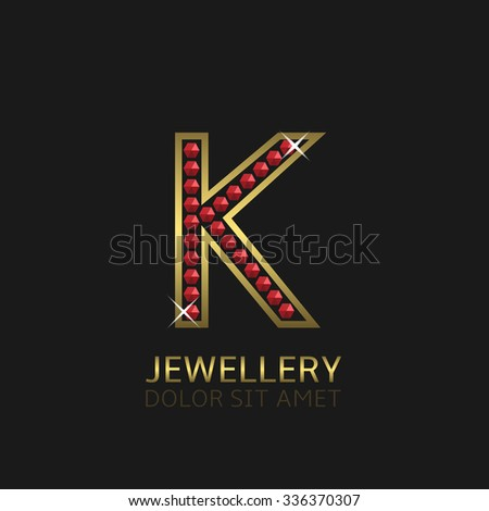 Golden Letter K logo with red precious stones. Luxury, royal concept. Vector illustration - stock vector