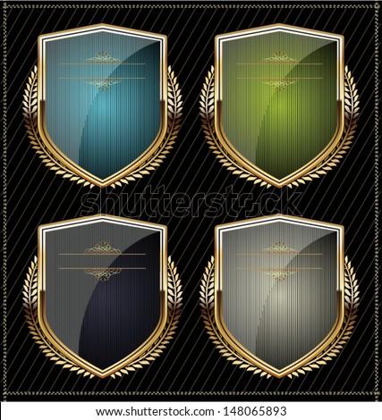 Golden shield design set with laurel wreath - stock vector