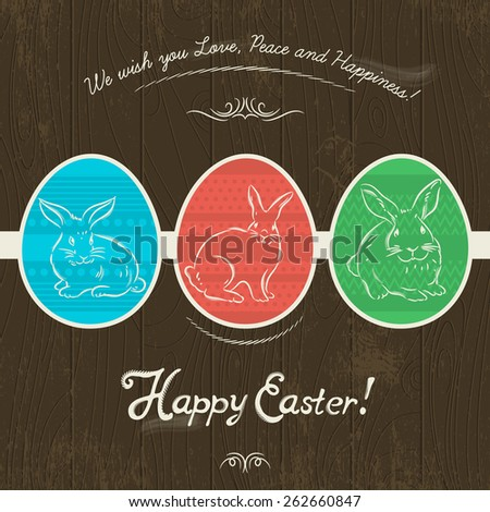 Greetings card with three colored Easter eggs painted with three rabbits. Wooden background and inscription Happy Easter.Decorative element in Eastern style. - stock vector