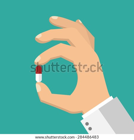 Hand holding a pill - flat style - stock vector