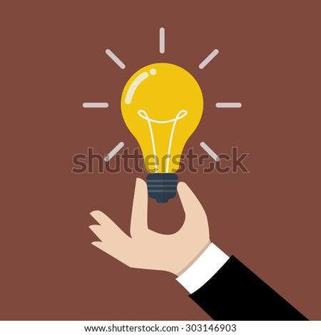 Hand holding light bulb. Business idea concept. - stock vector