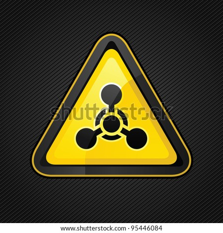Hazard warning triangle chemical weapon sign on a corduroy surface