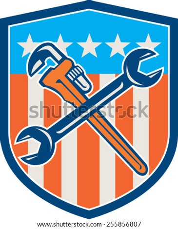 Illustration of a plumber's monkey wrench and mechanic's spanner crossed set inside shield with USA stars and stripes flag in background done in retro woodcut style. - stock vector