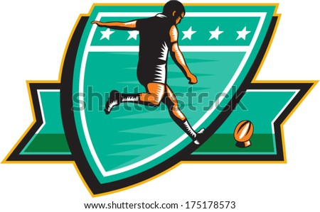 Illustration of a rugby player kicking ball rear view set inside shield on isolated background done in retro woodcut style. - stock vector