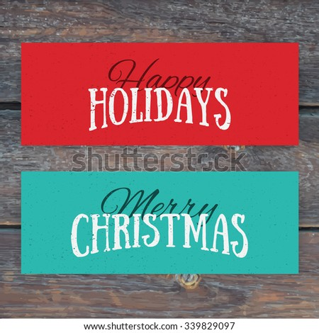 Illustration of colorful paper cards with Happy Holidays and Merry Christmas lettering. Christmas calligraphy on wood background. Vector banners. Xmas postcards. - stock vector
